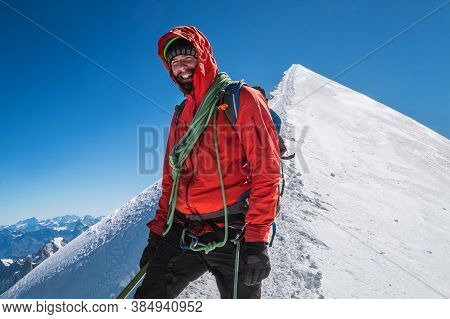 Last Steps Before Mont Blanc (monte Bianco) Summit 4,808 M Of Man With Climbing Axe Dressed Mountain