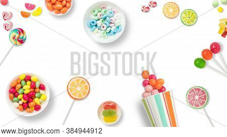 Lollipops And Candies. Colorful Sweets, Festive Decoration. Colorful Candies On A White Background,