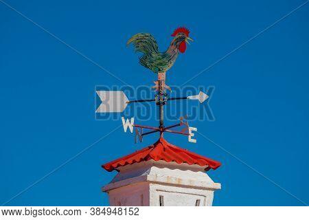 Portuguese Cock On Toportuguese Cock On Top Of The Chimneyp Of The Chimney.