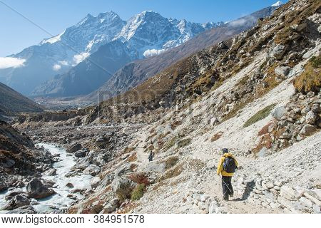 Back View Of Trekkers With Beautiful Landscape In Sagarmatha National Park, Nepal.