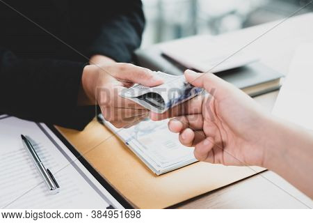 The Businesswoman Offers And Gives Money To His Partners For Bribery Of Bribery And Corruption.