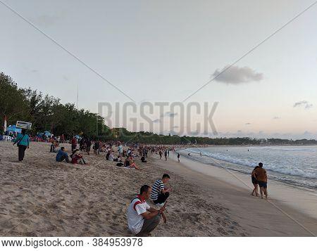 Badung Bali, Indonesia - September 26, 2019: Some People Having Activities On Kuta Beach On Sunset T