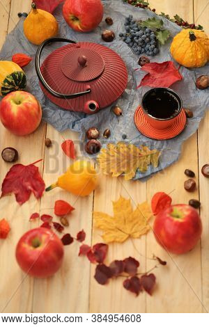 Autumn Tea Party.thanksgiving Day. Teapot, A Cup Of Tea, Apples,pumpkin, Chestnuts And Autumn Leaves