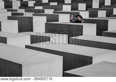 Berlin, Germany - March 26, 2017: Beautiful Woman Tourist Selfie At Holocaust Memorial To The Murder