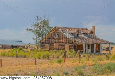 A Rustic, Rundown, Old Abandoned, Ruined, Farm House In The Countryside Of A Prairie In Colorado