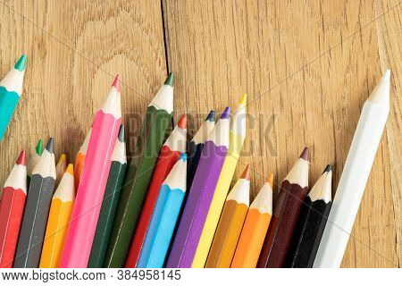 Close Up Of Multicolored Pencils On Wooden Background