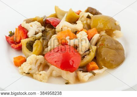 Mixed Pickled Vegetables In White Plate. Winter Salad