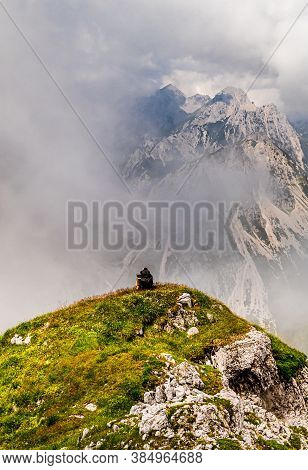Young Woman Summerhiker With Backpack From Behind Resting On Hill Onsteep Slopes, Panoramic Peaks