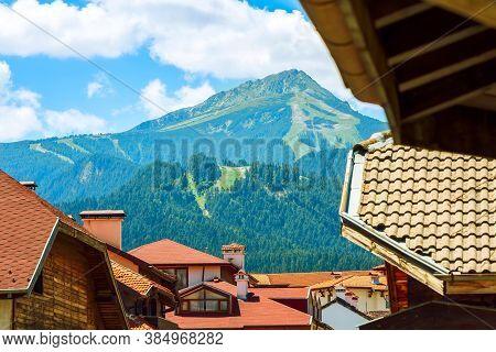 Todorka Mountain In Summer, Wooden Chalet Roofs Landscape Panorama In Bulgarian Ski Resort Bansko, B
