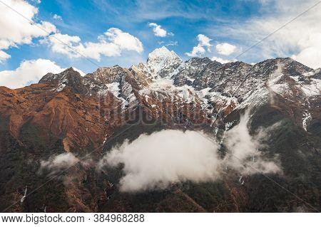 Clouds In Front Of Mt. Kangtega And Mt. Thamserku, Khumbu, Sagarmatha National Park. Trekking In Nep