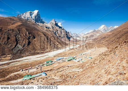 Aerial View Of Dingboche Village (4410 M) And Tawoche/taboche Peak. Trekking In Nepal Himalayas. Ebc