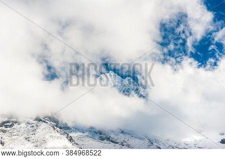 Fresh Snow On The Top Of Mount Kangtega Peak Hidden In Clouds. Trekking In Nepal Himalayas. Ebc (eve