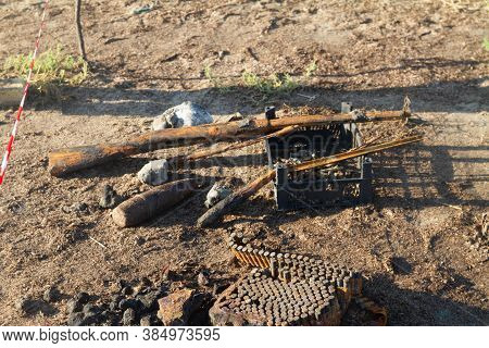 World War 2 Weapons And Ammunition Found At Sea. Old Rusty Shotgun And Ammunition, A Mine.  A Red An