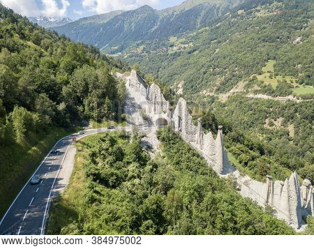 Euseigne, Switezrland - July 14, 2019: Aerial View Of Pyramides D'euseigne In Swiss Alp. Rocks Stay