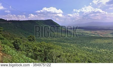 The Great Rift Valley In Kenya Is Covered In Impenetrable Jungle. Mountains Against The Blue Sky Wit