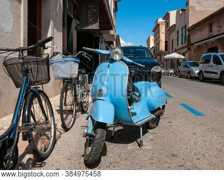 Campos, Balearic Islands/spain; September 2020: Light Blue Vespa 50 Motorcycle Parked In The Village