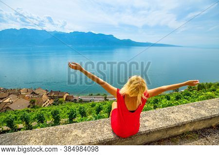 Happy Caucasian Tourist Woman Enjoying On Tour Wine Tasting In Lavaux Vineyard Terraces Overlooking