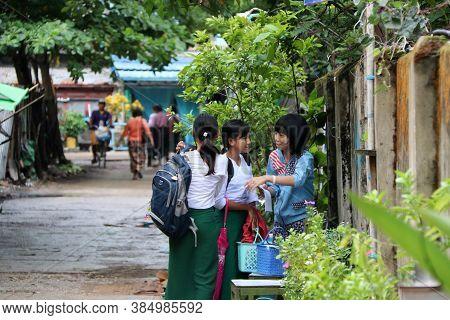 Yangon, Myanmar June 11, 2018: Three Girl Students In Myanmarese Uniform Of School (white Shirt And