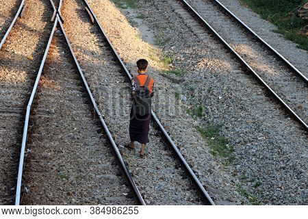 Yangon, Myanmar, Feb 20, 2019 : Back Side Of Myanmese Man In Short Sleeve T Shirt With Backpack And