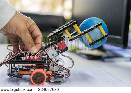 Student Learning Stem Education For Learn Coding Programming With Control Robot To Pick Up Model Glo