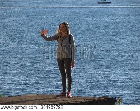 Oslo, Norway - Circa August 2017: Unidentified Girl Taking A Selfie By The Sea