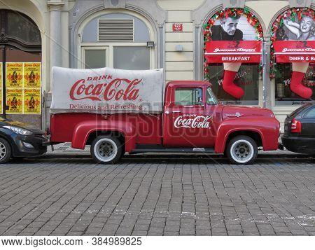 Prague, Czech Republic - Circa December 2017: Vintage Coca Cola Van Parked In A Street Of The City C