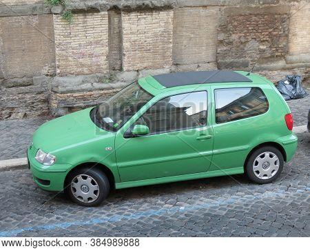 Rome, Italy - Circa October 2018: Light Green Volkswagen Polo Car