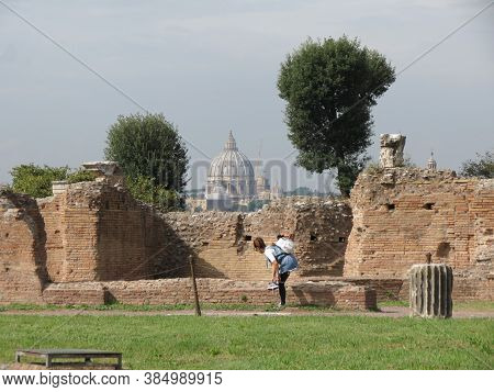 Rome, Italy - Circa October 2018: Palatine Hill With St Peter's Dome In The Background