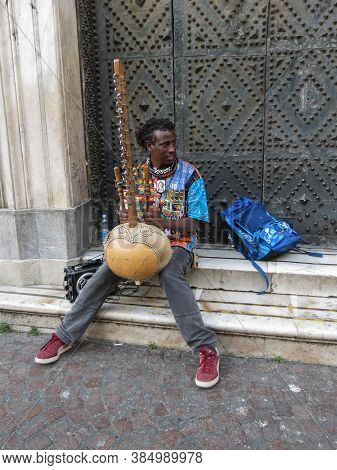 Naples, Italy - Circa June 2019: Unidentified African Harp Kora Player Performing In The Streets Of