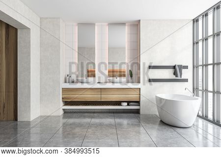 Interior Of Modern Bathroom With White Walls, Tiled Floor, Comfortable Bathtub And Double Sink. 3d R