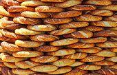 Traditional turkish crispy sesame bagels (simits) seen at a street vendor at Istanbul Turkey poster