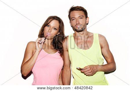 couple smoking e-cigarette on white background
