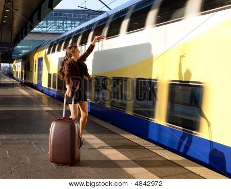 Beautiful Young Lady With Luggage Stop A Train