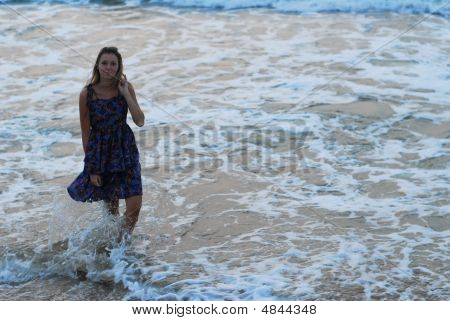 Beautiful Young Blond Girl Walking On Beach