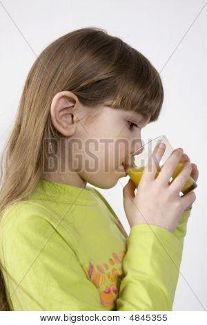 Little Cute Girl Drink Orange Juice