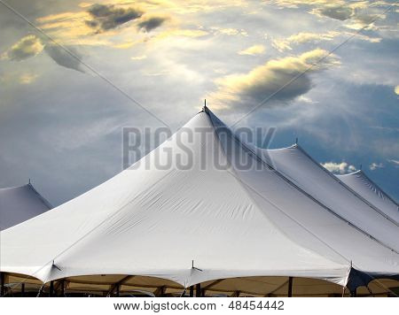 tent tops against a dramatic sky