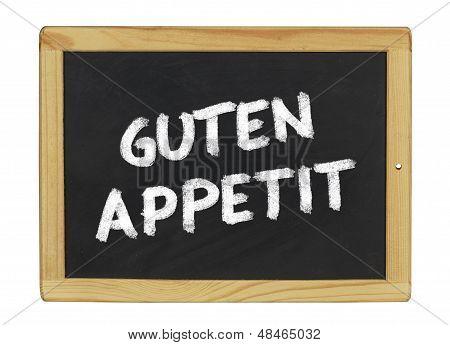 Guten Appetit (enjoy your meal) on a blackboard on a white background