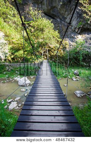 Suspended bridge inside Turda Gorges National Park, Transylvania - Romania poster