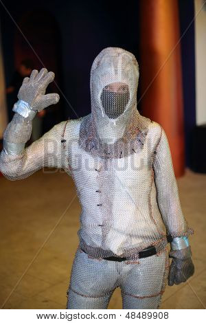 MOSCOW - FEBRUARY 8: Man in special chain mail at presentation of attraction Megavolt - master of lightning at VVC, on February 8, 2013 in Moscow, Russia.