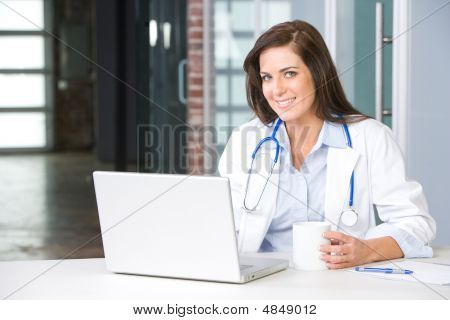 Woman Doctor Holding A Chart In A Modern Office