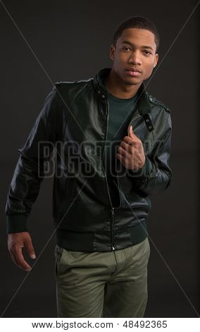 Casual Dressed Young African American Fashion Male Model Natural Looking on Grey Background