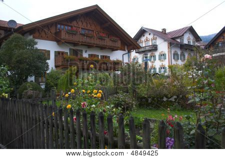 Beautiful faзade of Oberammergau building in Bavaria and garden poster