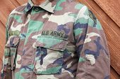 US Army soldier in camo uniform shirt poster