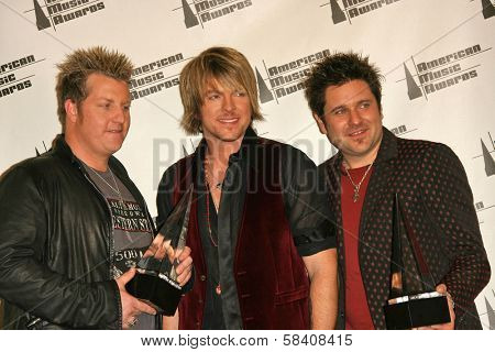 LOS ANGELES - NOVEMBER 21: Gary LeVox,  Joe Don Rooney and Jay DeMarcus (Rascal Flatts) at the 34th Annual American Music Awards at Shrine Auditorium on November 21, 2006 in Los Angeles, CA.