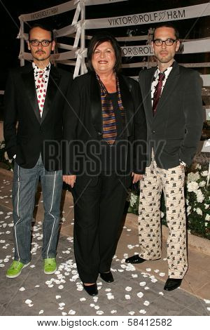 BEL AIR - OCTOBER 27: Viktor Horsting with Margareta Van Den Bosch and Rolf Snoeren at the H And M Celebration of the Viktor And Rolf Collection on October 27, 2006 at Private Residence, Bel Air, CA.