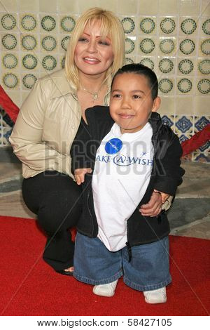 WESTWOOD, CA - DECEMBER 07: Joseph Calderon and his mother at the premiere of