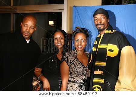 Warren G and Snoop Dogg with guests at the premiere of
