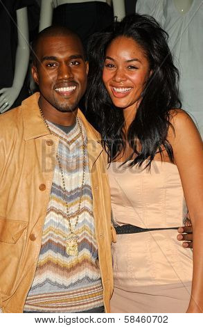 Kanye West and Alexis Rainey at the Stella McCartney`s Holiday Window Lighting to benefit the Kanye West Foundation Loop Dreams Program, Stella McCartney Boutique, Los Angeles, CA, December 5, 2006.