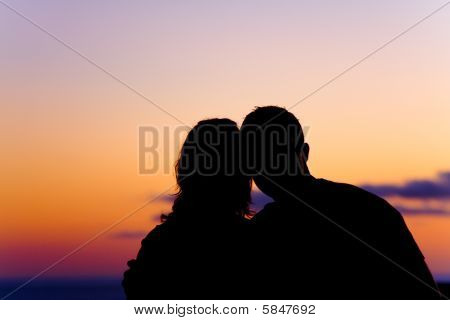 Beautiful Silhouette Of Couple At Sunset