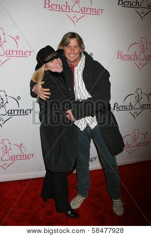 Cheryl Lynch and Chris Atkins at the Bench Warmer Trading Card's Holiday Party and Toy Drive. Area, Los Angeles, California. December 20, 2006.